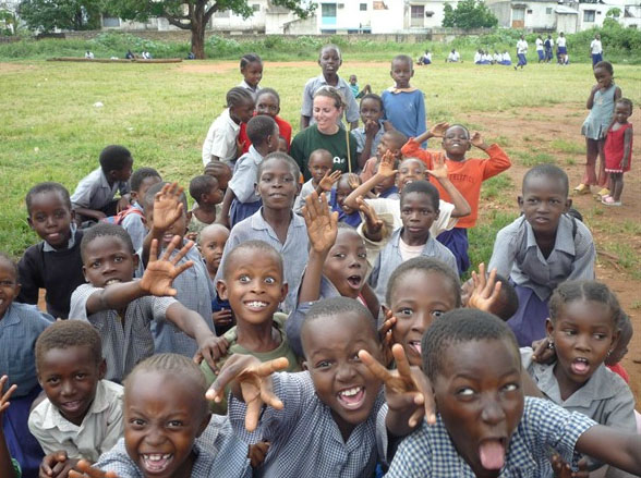 A volunteer with a group of children in Kenya